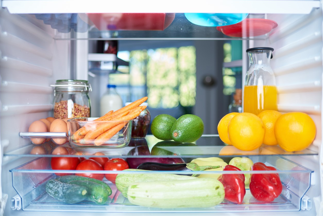 The inside of a refrigerator, filled with fresh fruits and vegetables.