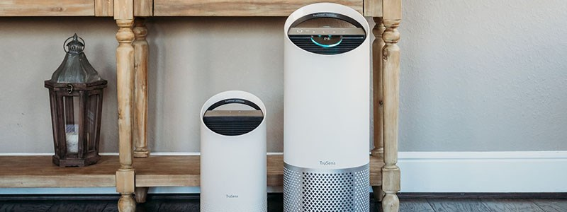 Two TruSens Air Purifiers on the floor of a home.