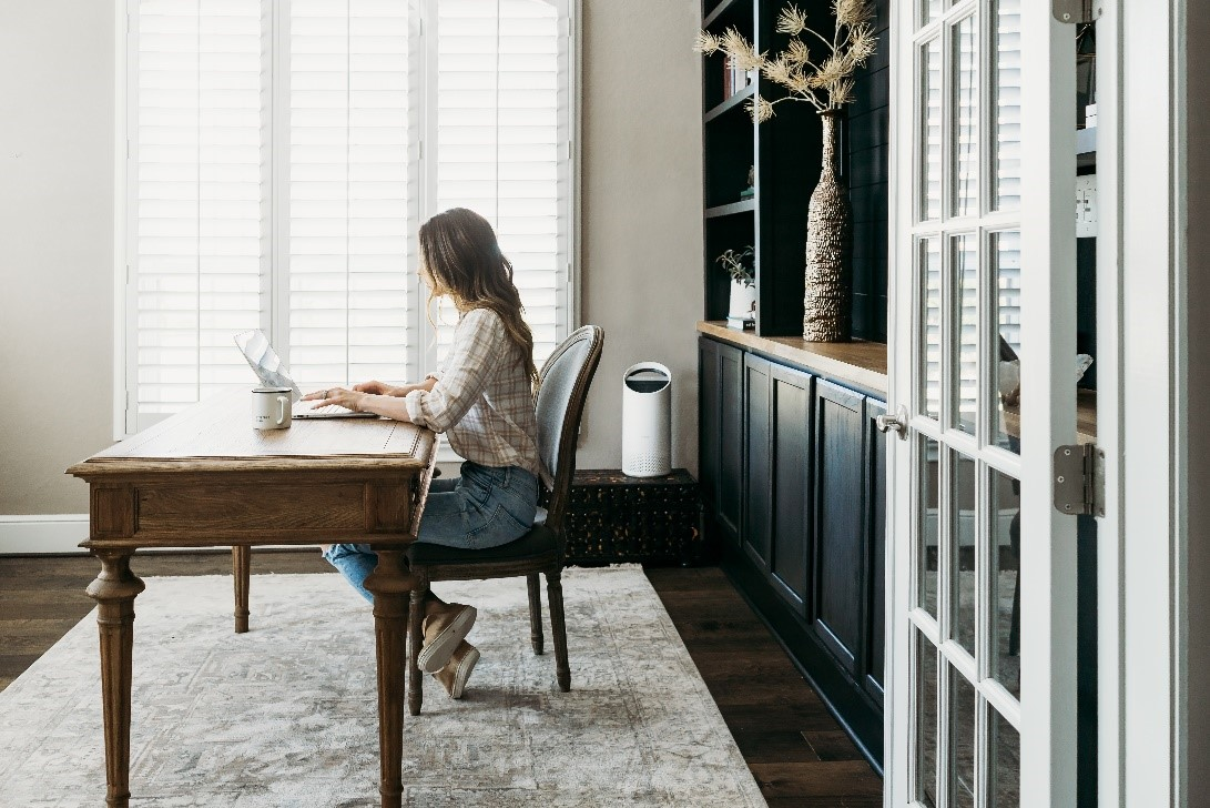Woman working in a home office.