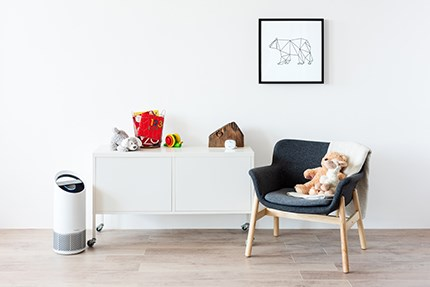 Medium air purifier on the floor in child room